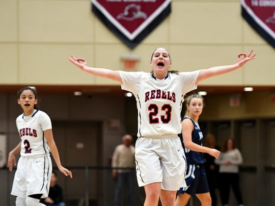 Saddle River Day's Michelle Sidor celebrates a three-pointer