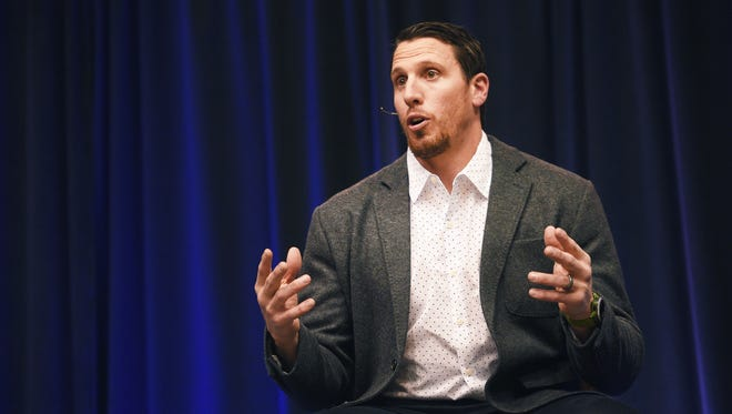 """Former Minnesota Vikings standout Chad Greenway is introduced during the """"Ahead of the Game: How Concussion Studies Can Make Sports Safer"""" event Sunday, Feb. 11, at the Sanford Pentagon."""