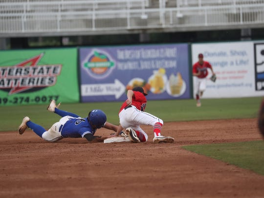 Canterbury's Camilo Lilleslatren is tagged out at second on an attempted steal.