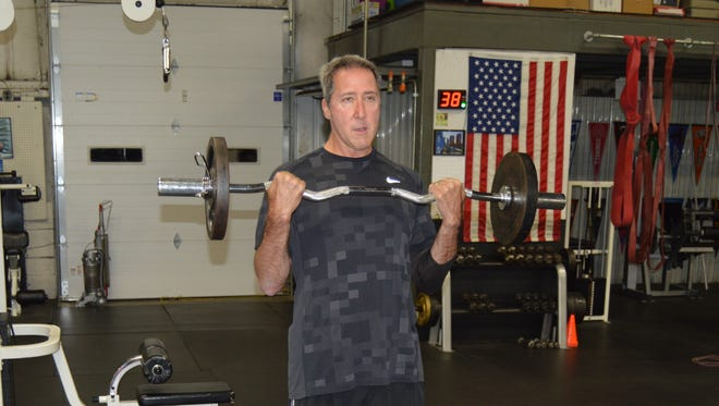 Greg Carmichael, the CEO of Fifth Third Bancorp, works out in a small gym in Blue Ash.