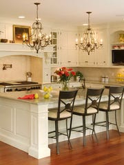 Stools can instantly make a kitchen island appear cozier, Ivee Fromkin of I. Fromkin Interiors says.