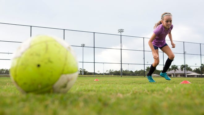 Rilee Morrison, 10, runs through a training drill while practicing for her upcoming soccer tryouts at North Collier Regional Park Wednesday, August 17, 2016 in Naples. The Collier County Planning Advisory Board is considering North Naples Regional Park as a possible expansion site to grow the counties' sports tourism. Expanding the park could mean reducing the preserves, where there are biking and walking paths.