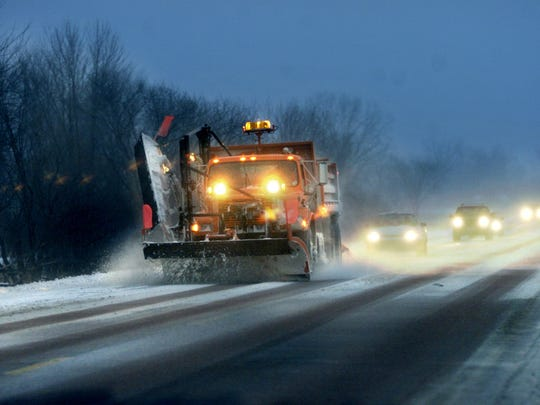 In this undated file photo, a Johnson County snow plow is followed by a line of motorists on Highway 1 southwest of Iowa City.