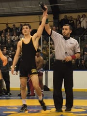 Cedar Grove's Anthony Clarizio becomes a four-time county wrestling champion at 132 pounds.