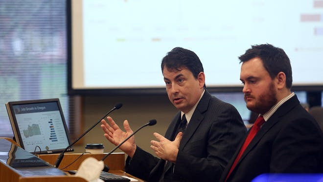 State economist Mark McMullen, left, and senior economist Josh Lehner present the Oregon Legislature with the first revenue forecast of the year Wednesday Feb. 12, 2014 and it shows little change but gives a more optimistic picture of the stateâ??s economy.