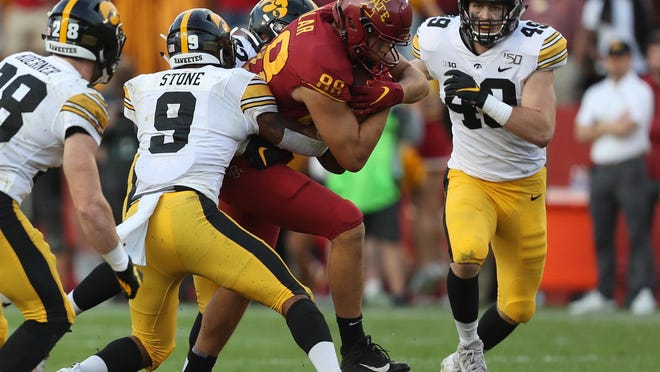 Iowa defensive back Geno Stone tackles Iowa State tight end Charlie Kolar during last year's 18-17 Hawkeyes victory at Jack Trice Stadium in Ames, Iowa. This year's game is scheduled Sept. 12, but the coronavirus could upend it or lead to a rematch.
