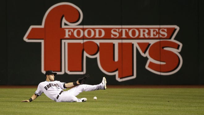 Arizona Diamondbacks center fielder Chris Owings misplays a fly ball from St. Louis Cardinals' Stephen Piscotty, who doubled and scored Aledmys Díaz in the 5th inning at Chase Field in Phoenix, Ariz., on Tuesday, April 26, 2016.