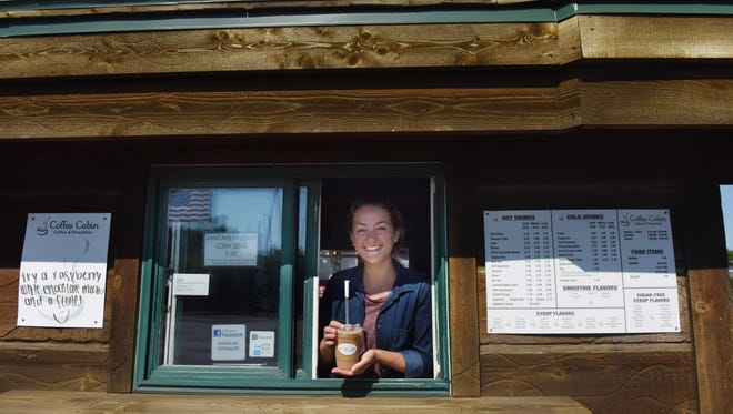 Kaylee Herding serves up an iced mocha at the Coffee Cabin off of South Minnesota Avenue.