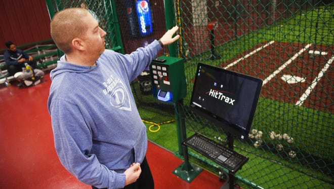 Vice President of operations Travis Slayden gives a tour of D-BAT, a baseball training facility, Friday, March 2, in Northern Sioux Falls. Slayden says the facility uses a field simulation that tells batters how many feet they hit the ball and where they would have hit the ball on an actual field. The simulation allows you to be on a baseball or softball field and allows you to choose your age group for younger batters. The facility is open to the public.
