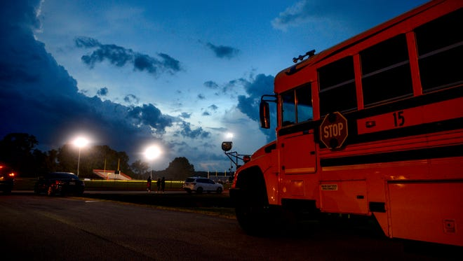 A Chester County Schools bus sits idle in the parking lot during a delay due to lighting in a TSSAA game between Chester County High School and University School of Jackson at University School of Jackson in Jackson, Tenn., on Thursday, Aug. 16, 2018.