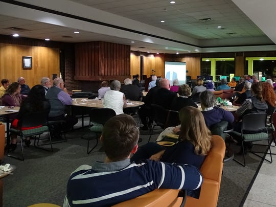 The crowd gathered at Thursday night's Ohio University - Chillicothe Heritage Day and 70th Anniversary Celebration at the regional campus watch a short video highlighting the history of OU-C.