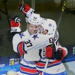 Jean Dupuy celebrates a goal by Matt Ellis in the first period on opening night, when the Amerks scored six goals. Since then they have scored two or fewer goals in nine of 13 games.