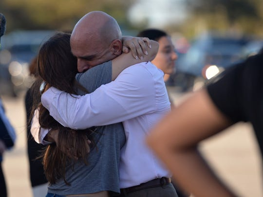 Hours after a shooting rampage at Marjory Stoneman Douglas High School in Broward County Wednesday afternoon, parents were waiting for their children outside the school (pictured) as well as at the Coral Springs Marriott.