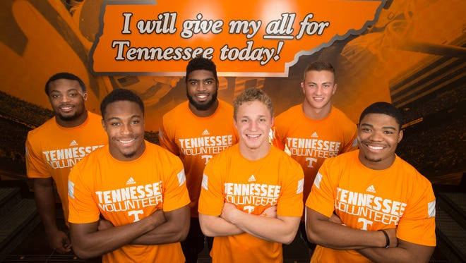 Tennessee football team freshmen Elliott Berry, Evan Berry, Neiko Creamer, Vic Wharton, Dillon Bates, and Todd Kelly Jr., from left, pose for a portrait at the University of Tennessee Anderson Training Center in Knoxville on July 18, 2014.