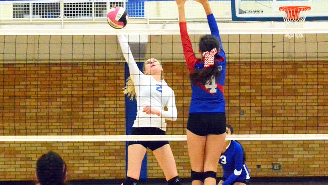 Carlsbad's Carrie Lynn gets a kill in the third set Tuesday.