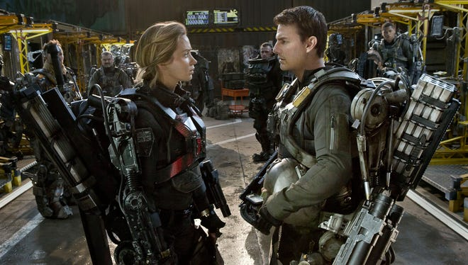 "Emily Blunt and Tom Cruise star in ""Edge of Tomorrow."""