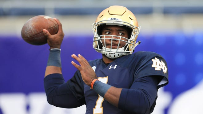 Notre Dame Fighting Irish quarterback Brandon Wimbush (7) warms up before the 2018 Citrus Bowl against the LSU Tigers at Camping World Stadium.