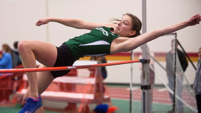 St. Johnsbury's Hannah Wescott clears the bar in the Division I girls high jump during the Vermont indoor track state championships on Saturday at Norwich University.