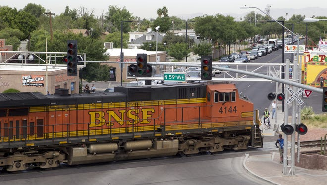A BNSF freight train rolls through the intersection of Glendale Avenue and 59th Avenue in Glendale. The Federal Railroad Administration said five of the 15 most dangerous railroad crossings in the U.S. are in Phoenix and Glendale along the BNSF railroad tracks near Grand Avenue.