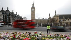 Flowers are left outside the Houses of Parliament in