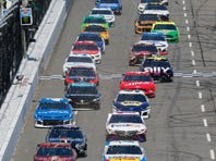 Joey Logano (22) leads the field at the start of a NASCAR Cup Series auto race at Martinsville Speedway in Martinsville, Va., Sunday, March 24, 2019. (AP Photo/Steve Helber)
