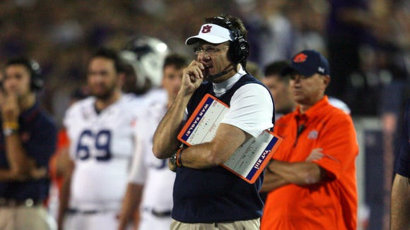 Auburn coach Gus Malzahn denied his team stole Kansas State's signals.