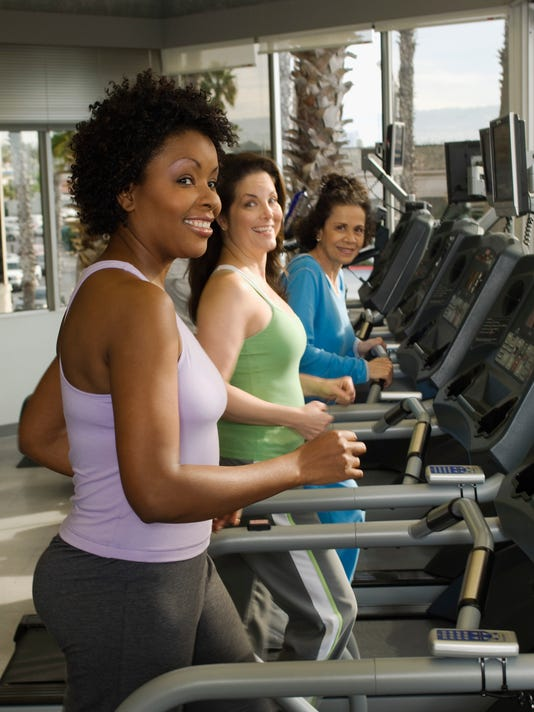 Women Exercising on Treadmills at Health Club