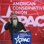 "Phil Robertson of TV show ""Duck Dynasty"" gestures as he speaks at the 42nd annual Conservative Political Action Conference (CPAC) February 27, 2015 in National Harbor, Maryland. Conservative activists attended the annual political conference to discuss their agenda."
