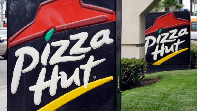 This Oct. 5, 2010 file photo shows the front of a  Pizza Hut restaurant in Los Angeles.   Pizza Hut says it will remove more artificial ingredients from its pizza pies in the next year. Pizza Hut says the preservatives BHA and BHT will be removed from all its meat by July 2016. Artificial preservatives in cheese will be cut by next year. Chicken used as pizza topping will be free of human antibiotics by March.