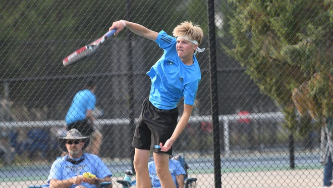 Pueblo West High School sophomore Nathan Kleven serves during he and teammate Travis Persons' 6-2, 6-1 win over Central's Kadyn Betts and Sergio Sandoval in the Class 4A Region 7 No. 2 doubles championship match at City Park Friday.