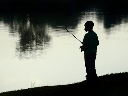 Children fish during the Montgomery County Sheriff's Department kids fishing rodeo in Montgomery, Ala. on Saturday June 21, 2014.