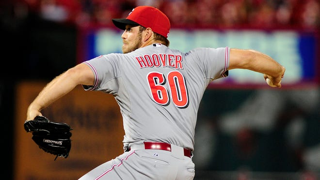 Cincinnati Reds relief pitcher J.J. Hoover (60) throws to a St. Louis Cardinals batter during the ninth inning at Busch Stadium. The Cardinals defeated the Reds 5-4.