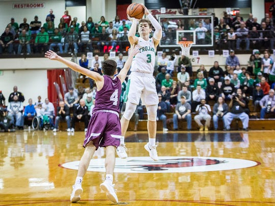 New Castle's Luke Bumbalough shoots past Culver's defense