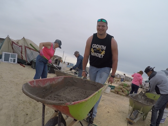 Southern Miss offensive lineman Drake Dorbeck hauls stucco during a mission trip to Puerto Peñasco, Mexico, in March.