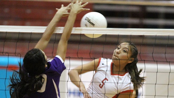 Shiprock's Tanisha Begay hits the ball during a game against Kirtland Central on Tuesday at the Chieftain Pit.
