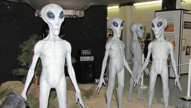 Alien statues posed outside a  flying saucer are the centerpiece exhibit at the International UFO Museum in Roswell.
