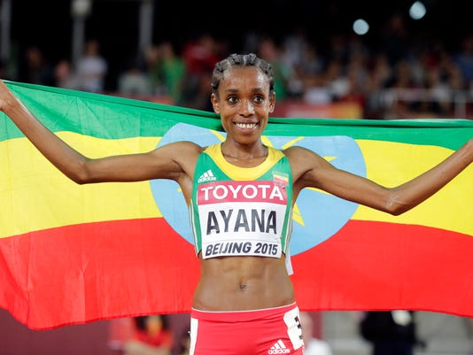 FILE - In this Sunday Aug. 30, 2015 file photo, Ethiopia's Almaz Ayana celebrates after winning the gold in the women's 5000m in a championship record time of 14:26.83 at the World Athletics Championships at the Bird's Nest stadium in Beijing, 2015. Almaz Ayana, Ethiopia's rising star, was selected to run in the women's 5,000 and 10,000 in Rio de Janeiro. (AP Photo/Andy Wong, File)