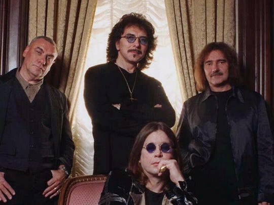 Members of the heavy metal band Black Sabbath pose in New York Oct. 16, 1998. Seated is Ozzy Osbourne. Standing from left are Bill Ward, Tony Iommi and Geezer Butler.