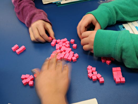 Fourth grade students use objects to help them divide during a math class at the Cottage Lane Elementary School in Blauvelt Jan. 23, 2014.