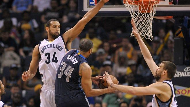 Dallas Mavericks guard Devin Harris (34) shoots the ball between Memphis Grizzlies forward Brandan Wright (34) and Grizzlies center Marc Gasol (33) during the first half at FedExForum.
