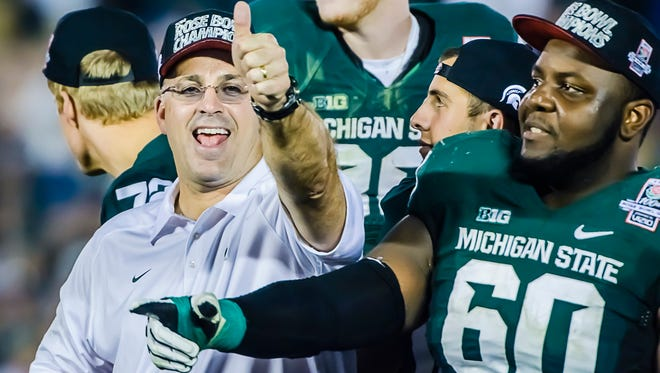 Michigan State defensive coordinator Pat Narduzzi flashes a thumbs-up after beating Stanford in the 2014 Rose Bowl.