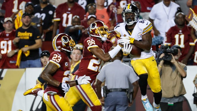 Pittsburgh Steelers wide receiver Antonio Brown (84) pulls in a touchdown pass under pressure from Washington Redskins cornerback Bashaud Breeland (26) during the first half of an NFL football game in Landover, Md., Monday, Sept. 12, 2016.