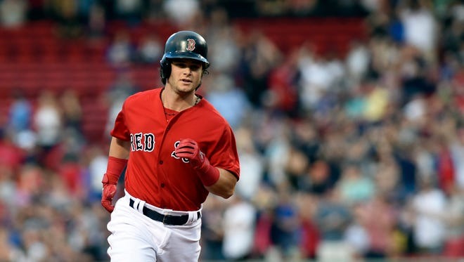 Red Sox left fielder Andrew Benintendi (16) rounds the bases after hitting a home run during the first inning against the Chicago Cubs at Fenway Park.