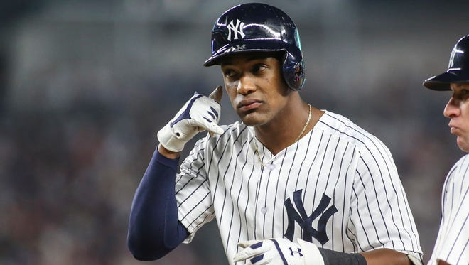 New York Yankees third baseman Miguel Andujar (41) looking at his teammates in the dugout after hitting a single in the third inning.