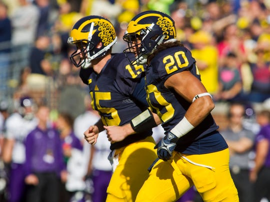 Michigan quarterback Jake Rudock (15) and running back Drake Johnson (20) on Oct. 10, 2015.