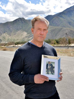 Allan Joy holds a photo of his deceased husband, Ed ONeil, whose untimely death prompted Joy to encourage people to get tested for HIV.