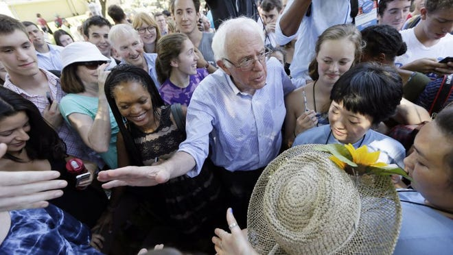 Democratic presidential candidate, Sen. Bernie Sanders, I-Vt., greets supporters following a town hall meeting on Sept. 3, 2015, in Grinnell, Iowa.
