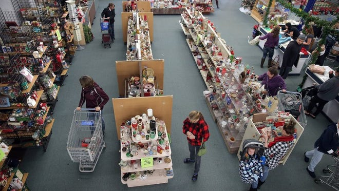 Shoppers look for Christmas decorations Monday at the St. Vincent de Paul Thrift Store in Port Orchard. The store needs some investment capital to purchase a new property in Port Orchard.   LARRY STEAGALL / KITSAP SUN
