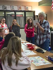 Cedar Middle Creative Writing class gets hands-on bookmaking instructions from guest artist Mona Woolsey