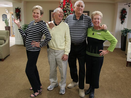 Charlotte Nossaman and her husband Elmer and Roger Yardo and his wife Kitty (from left to right), recreate their pose in The Flintstones photo shoot.
